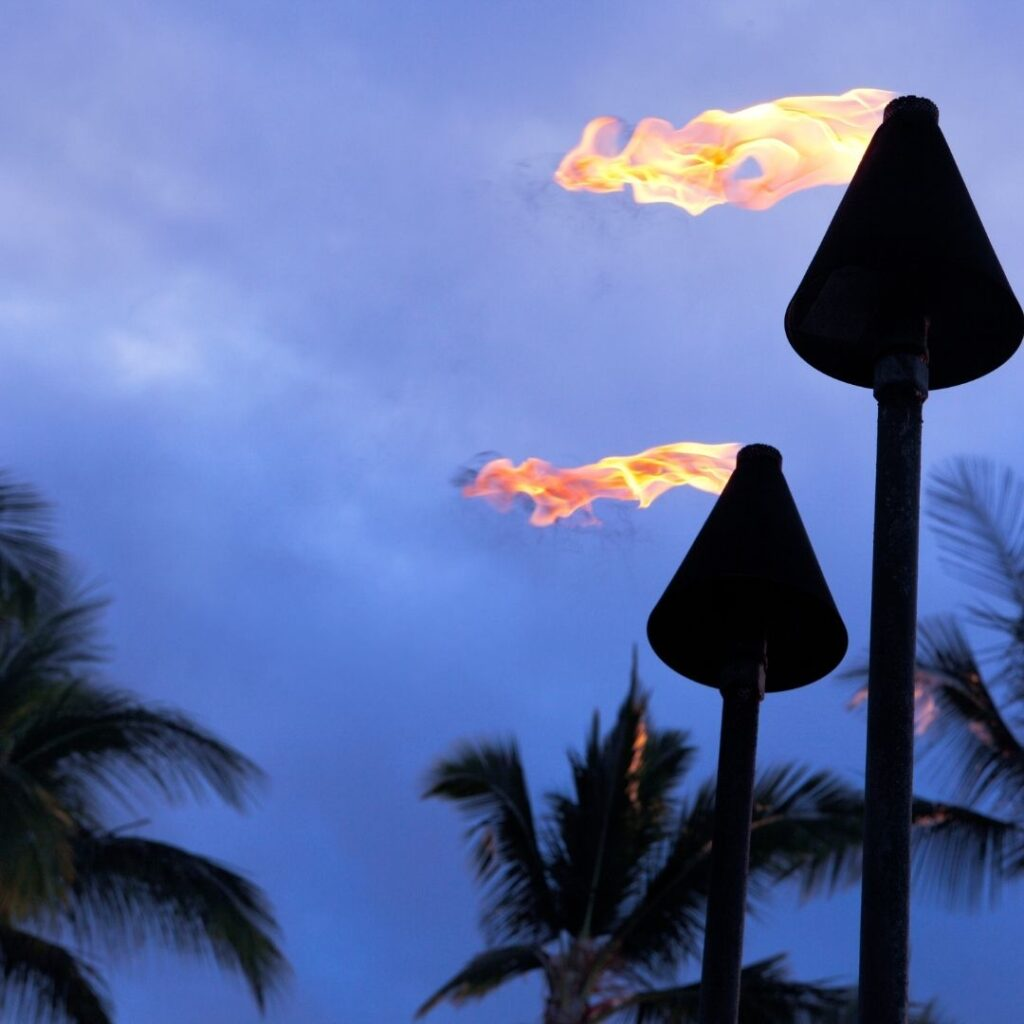 Tiki torches at Polynesian cultural center which runs the Alii luau, one of the best luaus in Hawaii